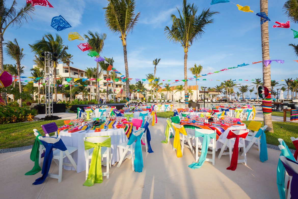 Outdoor space at resort set up for business celebration photographed by Adventure Photos