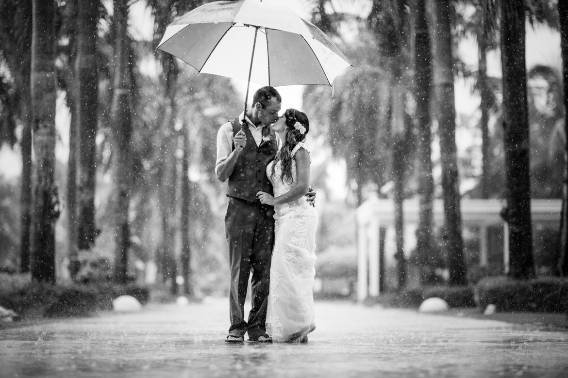 Romantic bridal portrait in the rain captured by Adventure Photos