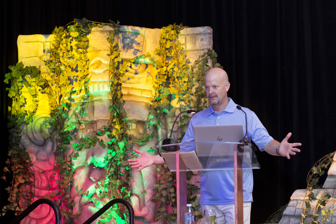 Professional event photograph captures keynote speaker at company event.