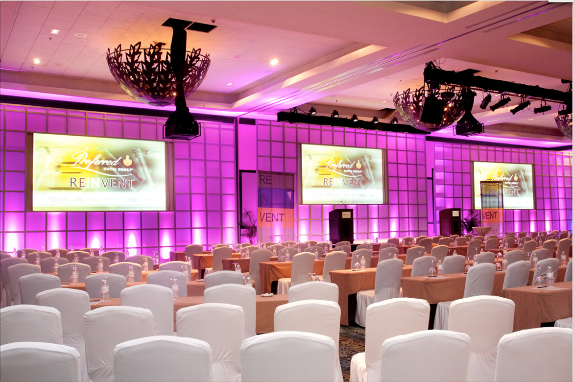 Large ballroom set up for the business conference captured by Adventure Photos