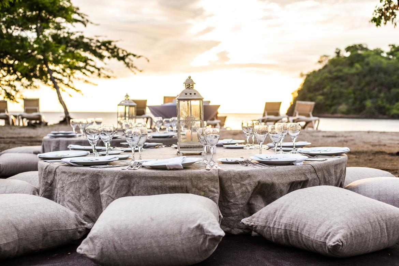 Bohemian style table setting for marketing photo shoot of beach wedding venue