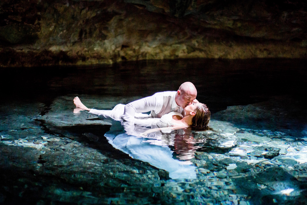 Romantic trash the dress photo in crystal waters following destination wedding