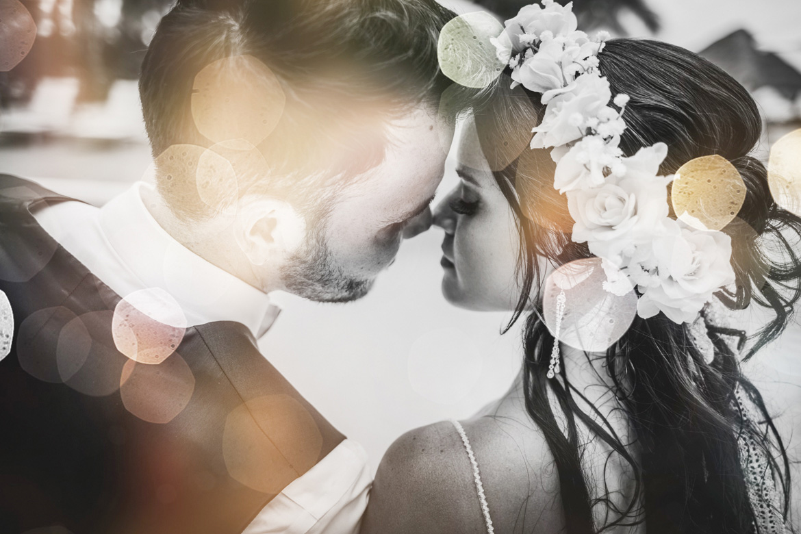 Close up of photo of bride and groom at tropical destination wedding in black and white