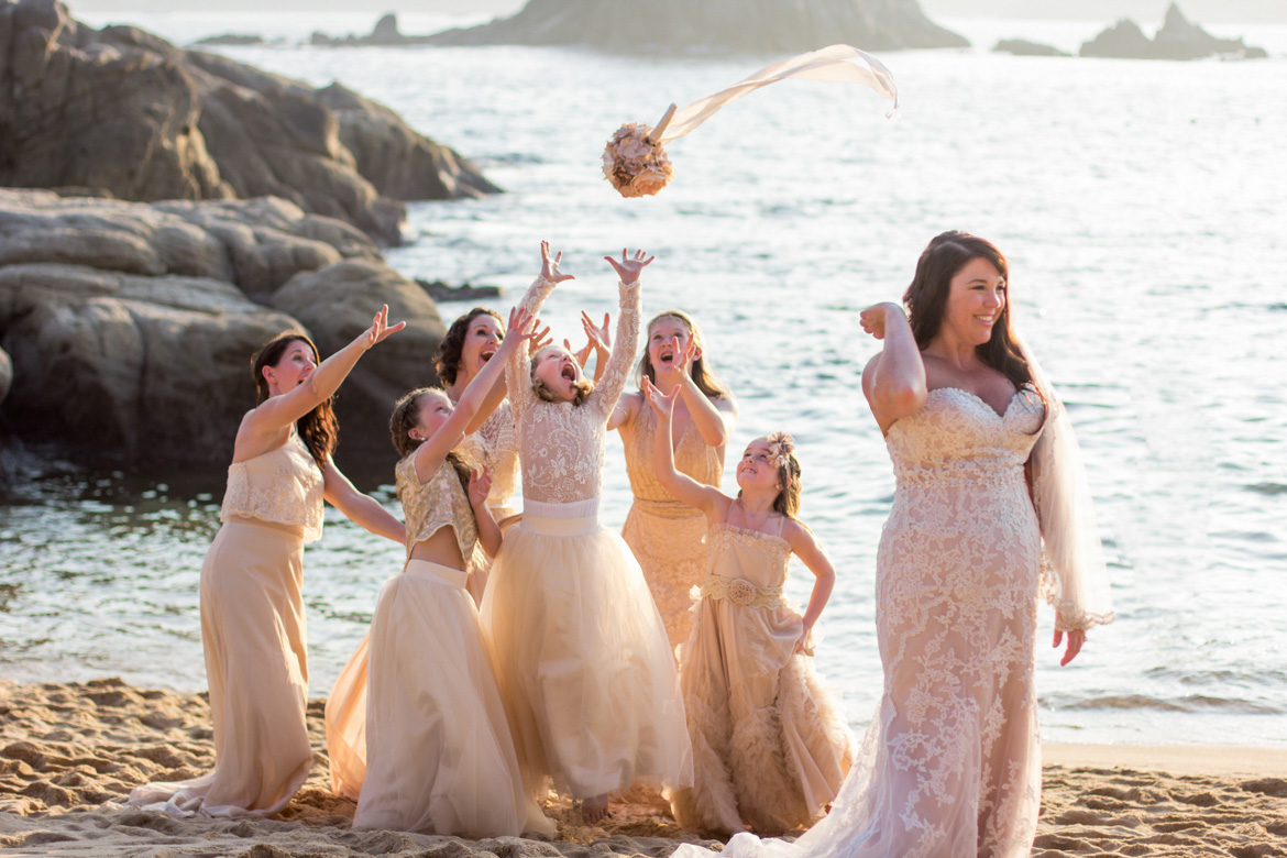 Bouquet toss on beach at destination wedding captured by Adventure Photos