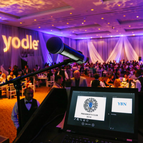 Ballroom of corporate employees at yodle event for the presidents club captured by corporate event photographers at Adventure Photos