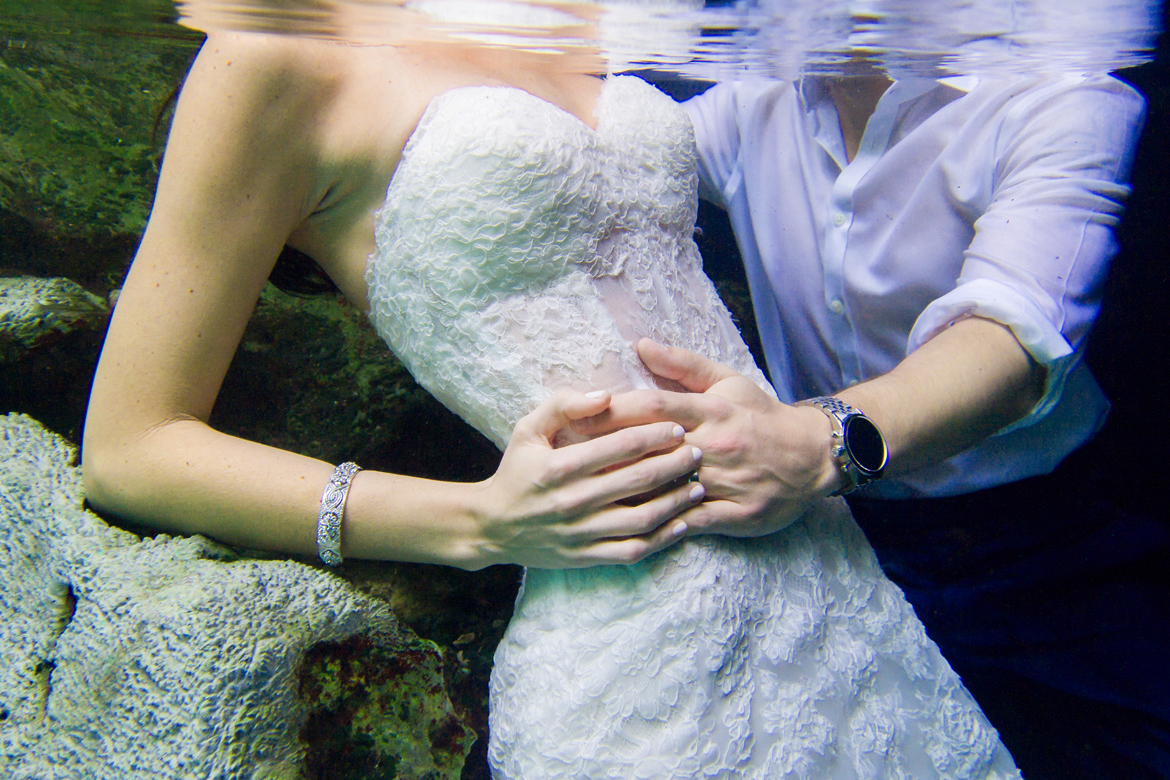 Underwater shot of bride and groom in trash the dress photo shoot with Adventure Photos