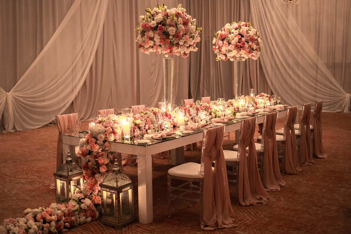 Ornate harvest table set up of destination wedding reception