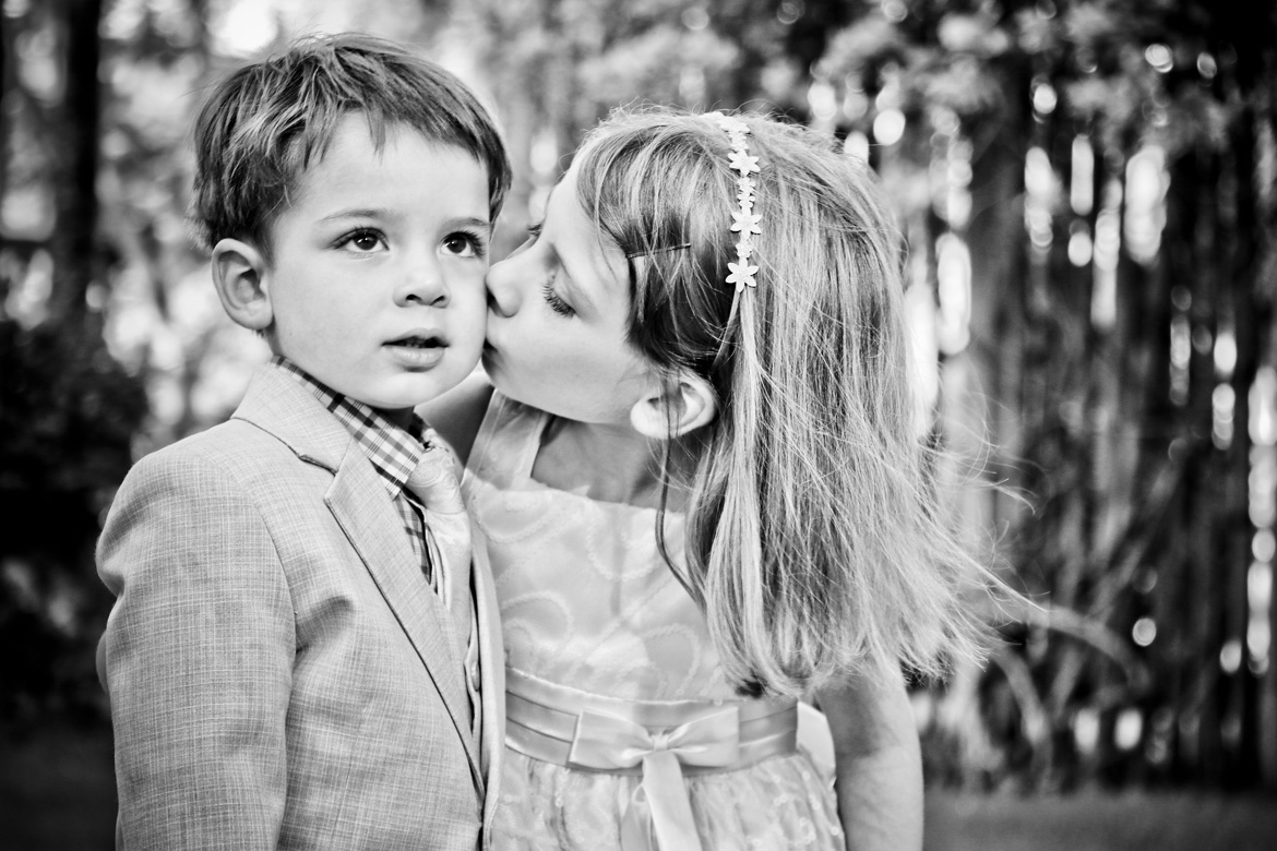 Candid photo of flower girl and ring bearer at destination wedding captured by Adventure Photos