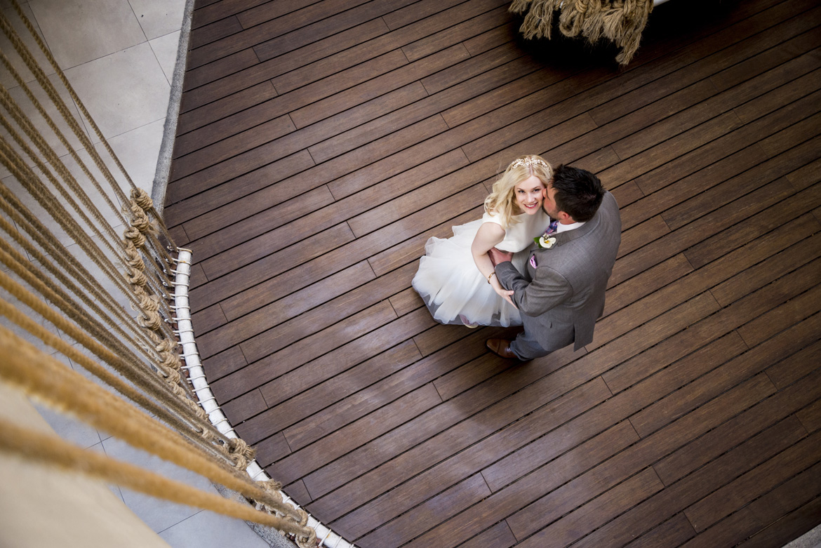 Aerial shot of bride and groom at destination wedding captured by Adventure Photos