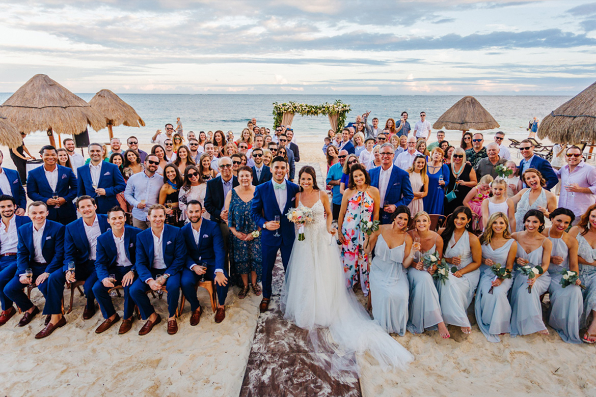 Group photo of all guests and bridal party after destination wedding ceremony captured by Adventure Photos