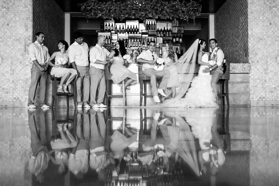 Candid style wedding photo of bridal party at bar during destination wedding