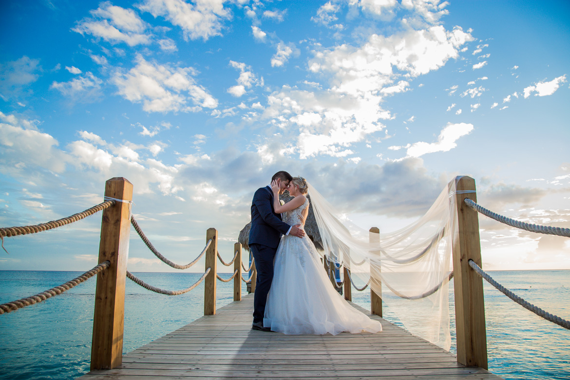Bridal portrait of couple on dock at destination wedding captured by Adventure Photos