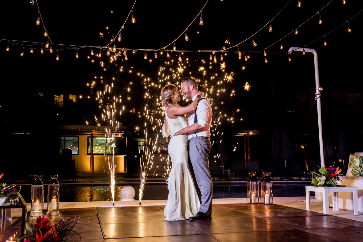 Photo of couple during first dance at outdoor nighttime destination wedding reception