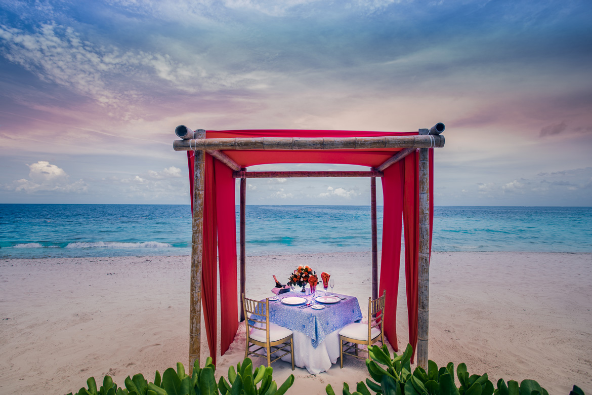 Professional marketing photo for romantic dinner on the beach at a tropical resort
