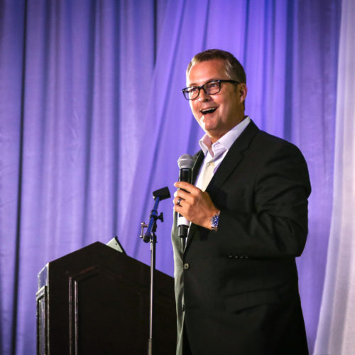 Speaker at conference photographed by professional corporate event photographers