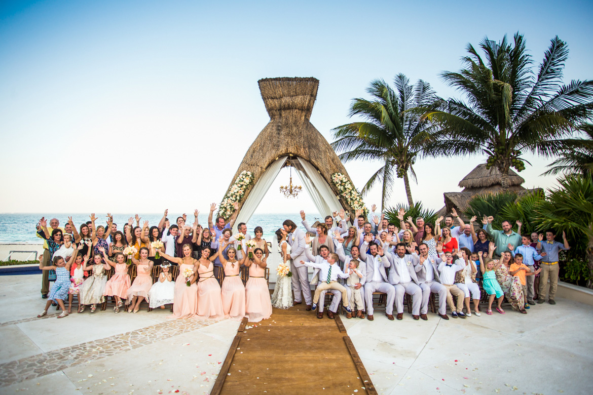 Group photo at destination wedding captured by Adventure Photos