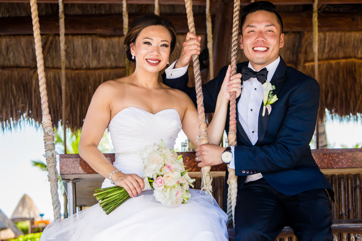 Destination wedding photo of couple on swings captured by Adventure Photos