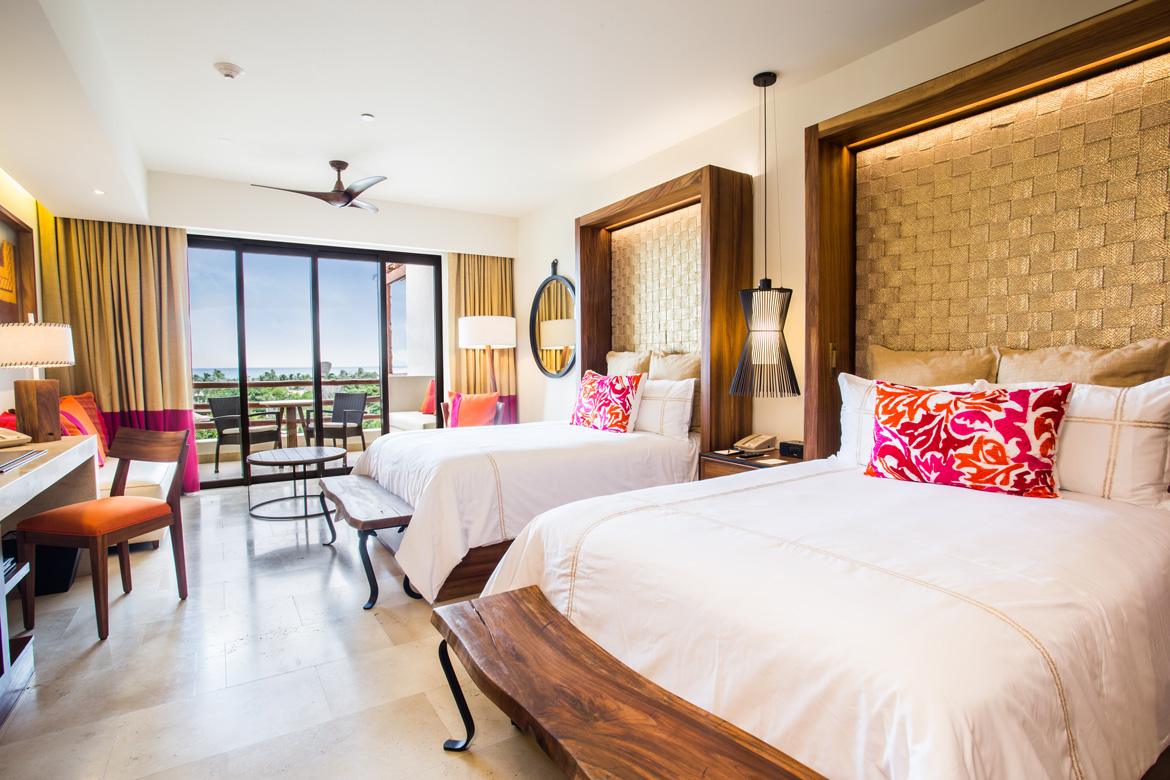 Suite with 2 Queen beds at luxury resort photographed for marketing materials