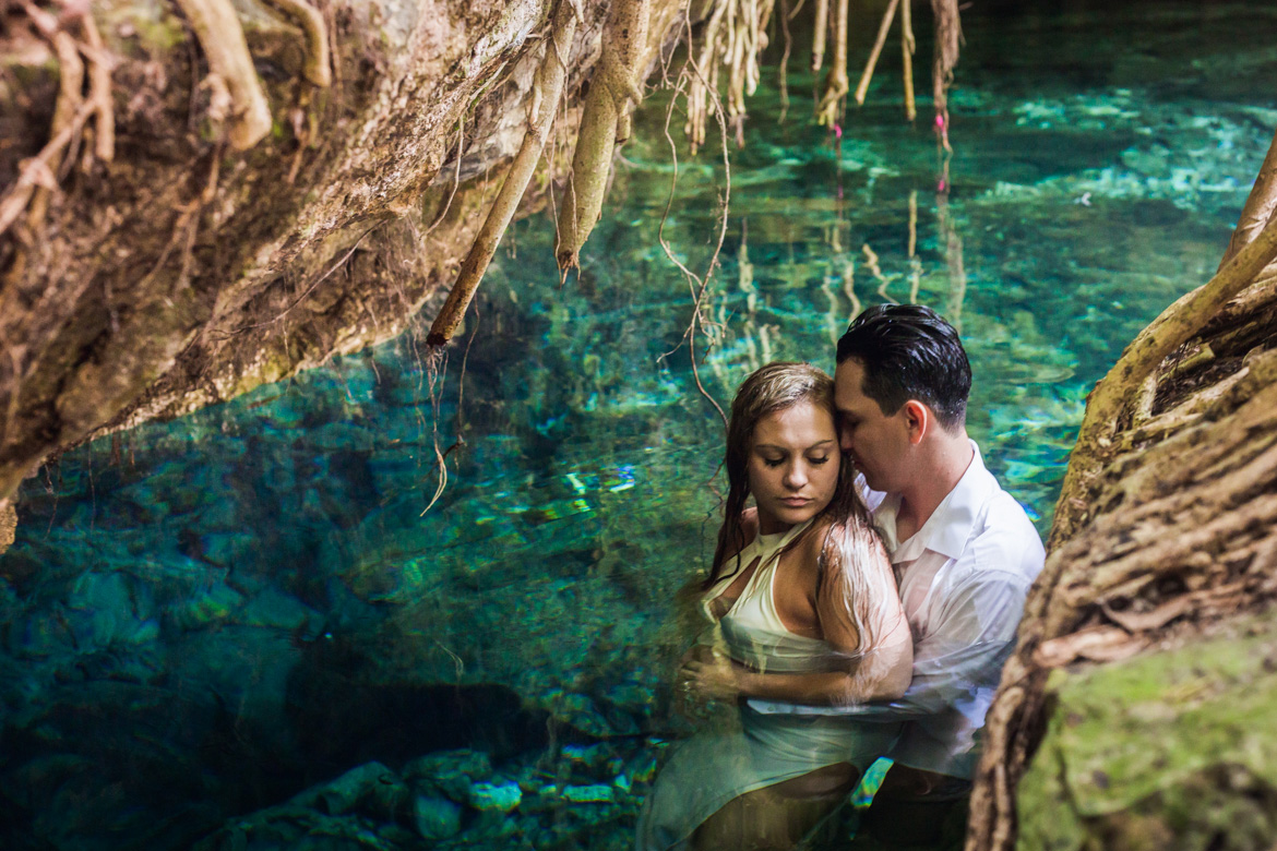 Couple in a cenote during intimate trash the dress photo session