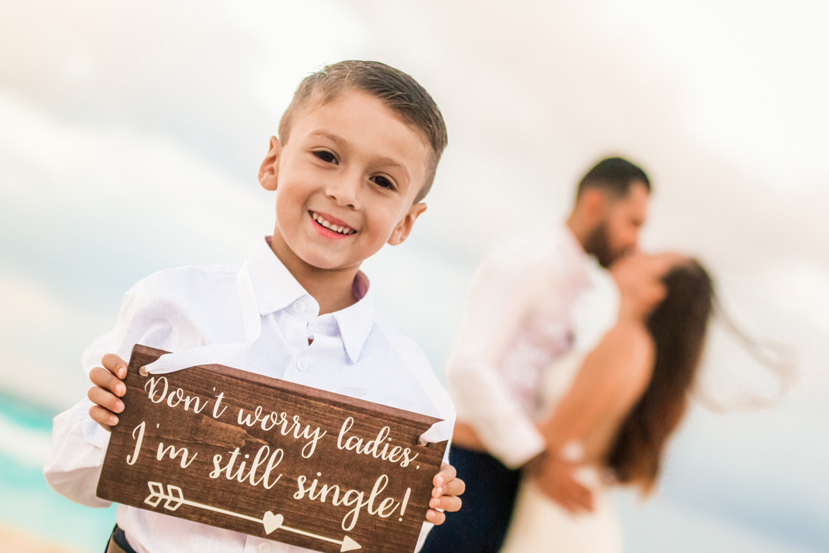 Ring bearer holding sign in adorable destination wedding photo