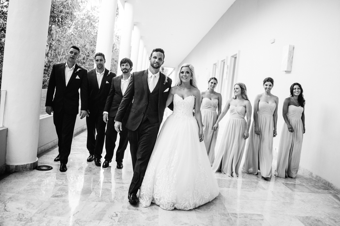 Bride and groom with bridal party in black and white destination wedding photo