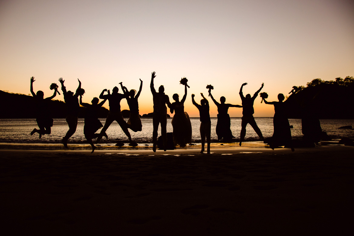 Sunset bridal party photo at destination wedding