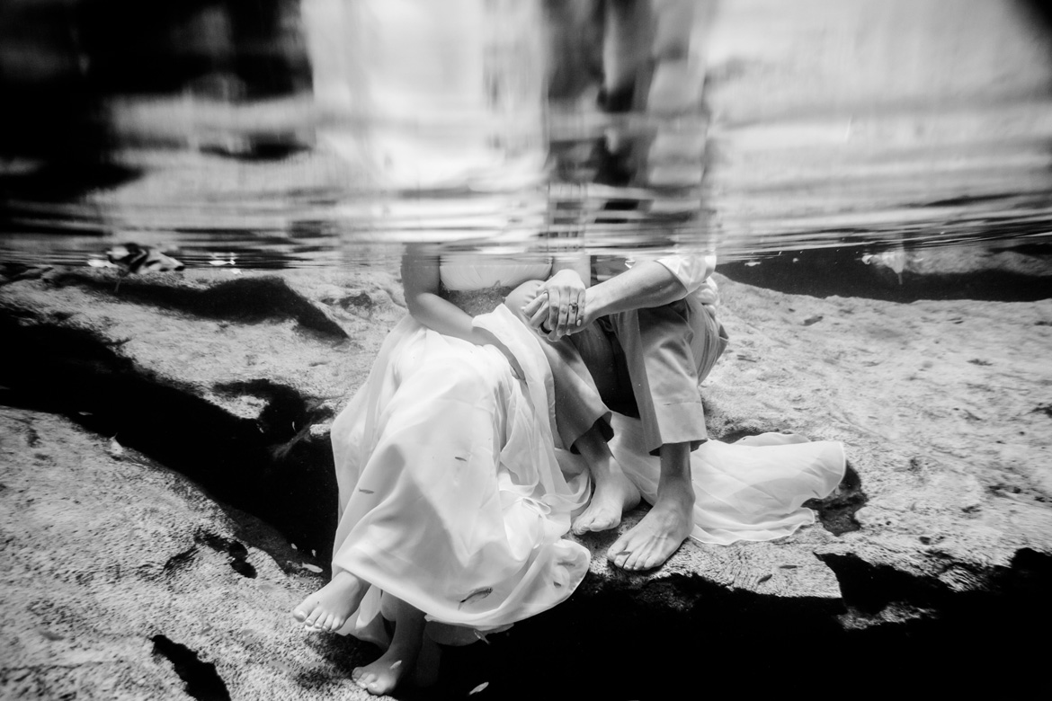 Black and white trash the dress photo of bride and groom in the water