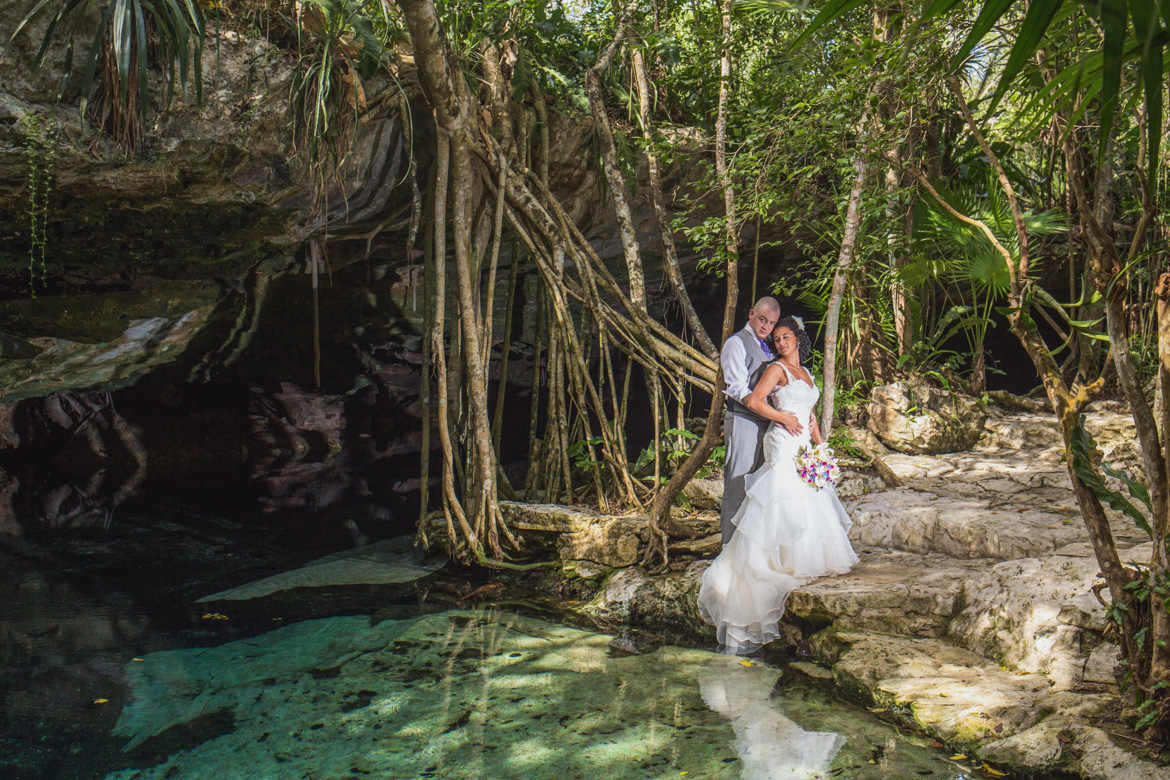 Unique bridal portrait during trash the dress photo session in tropical jungle