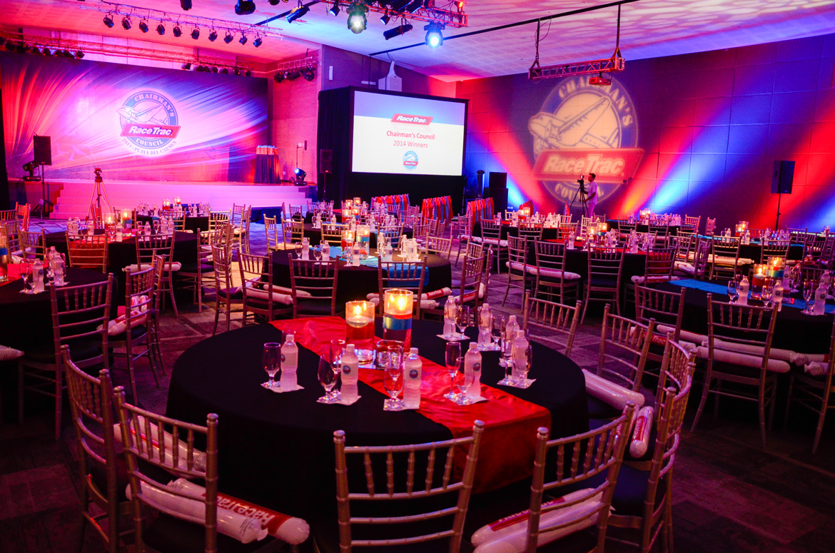Ballroom set up for RaceTrac Chairman's Counci's corporate event photographed by Adventure Photos