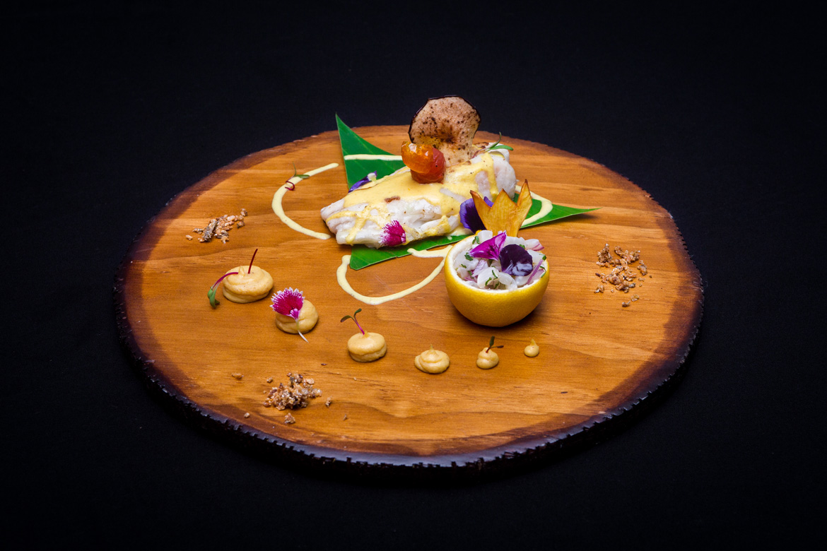 Bright and colourful seafood dish on wooden board captured by the food photographers at Adventure Photos