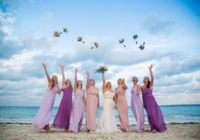 Bridesmaids throwing flowers into the air