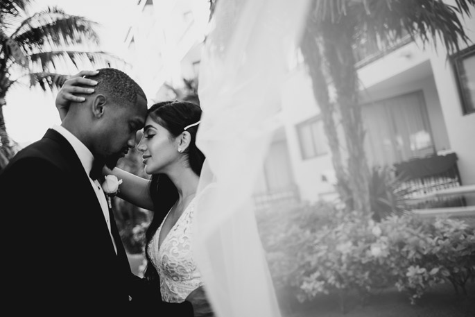 Romantic photo of bride and groom the moment before they kiss