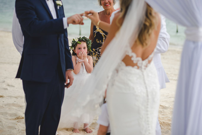Image of the couple exchanging rings at destination wedding by the photojournalist photographers at Adventure Photos