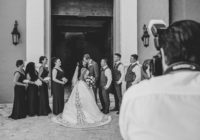Wedding photographer capturing a black and white photo