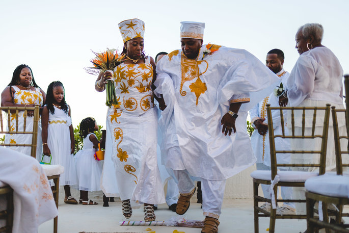 Couple jumping the broom