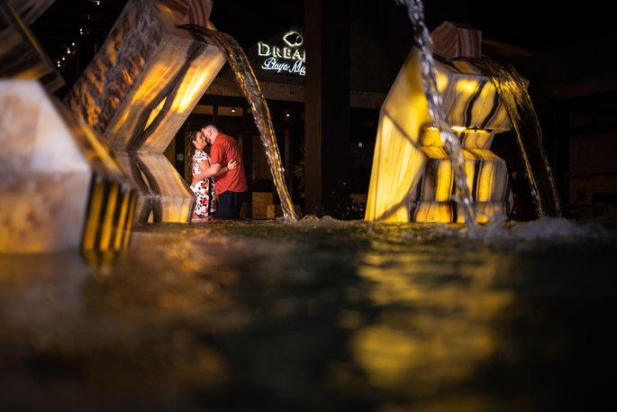 couple outside of a hotel with reflective water