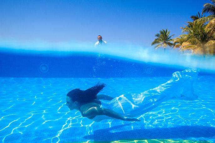 bride swimming underwater