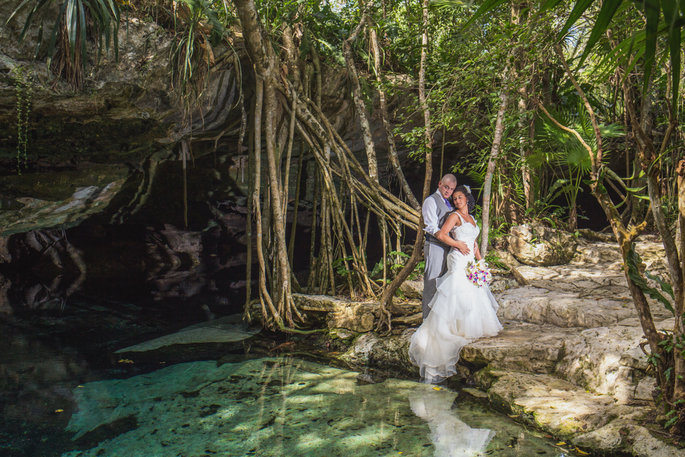 couple on their wedding day posing in a beautiful cave like landscape
