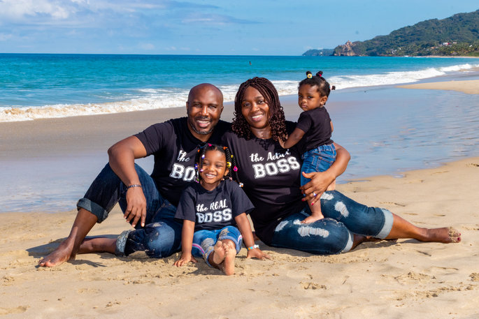 beautiful family posing for a photo on the beach in funny tee shirts