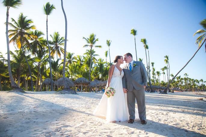 couple posing on the beach for their wedding day photos