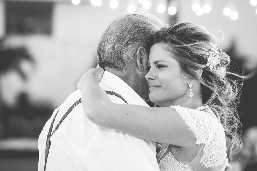 Candid Photo of Fathers First Look with Bride taken by Adventure Photos