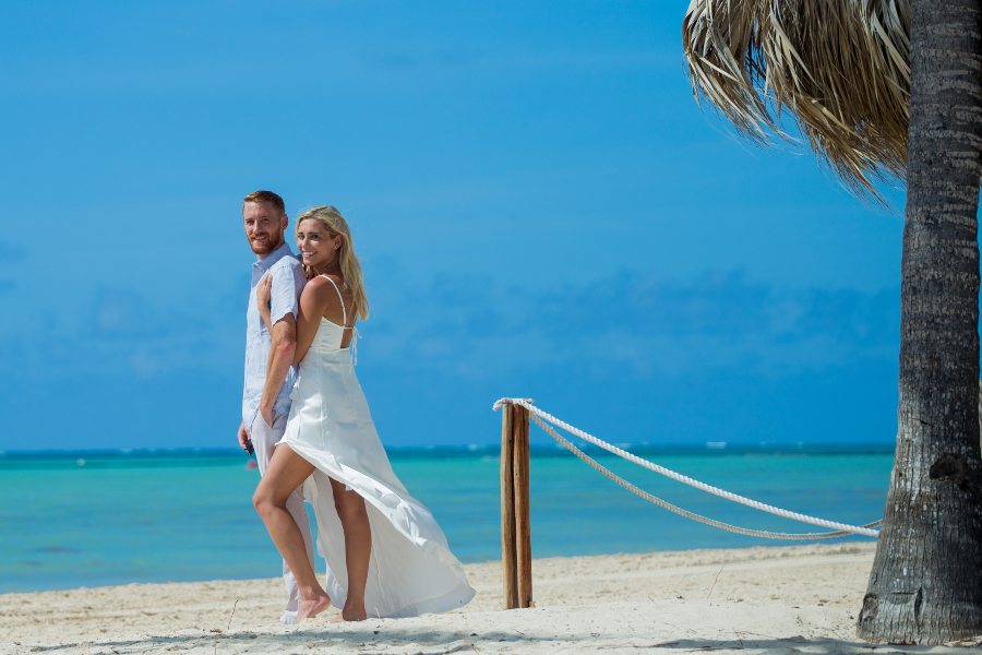 Couple Having a Romantic Beach Photo Session at Secrets Resorts & Spa with Adventure Photos