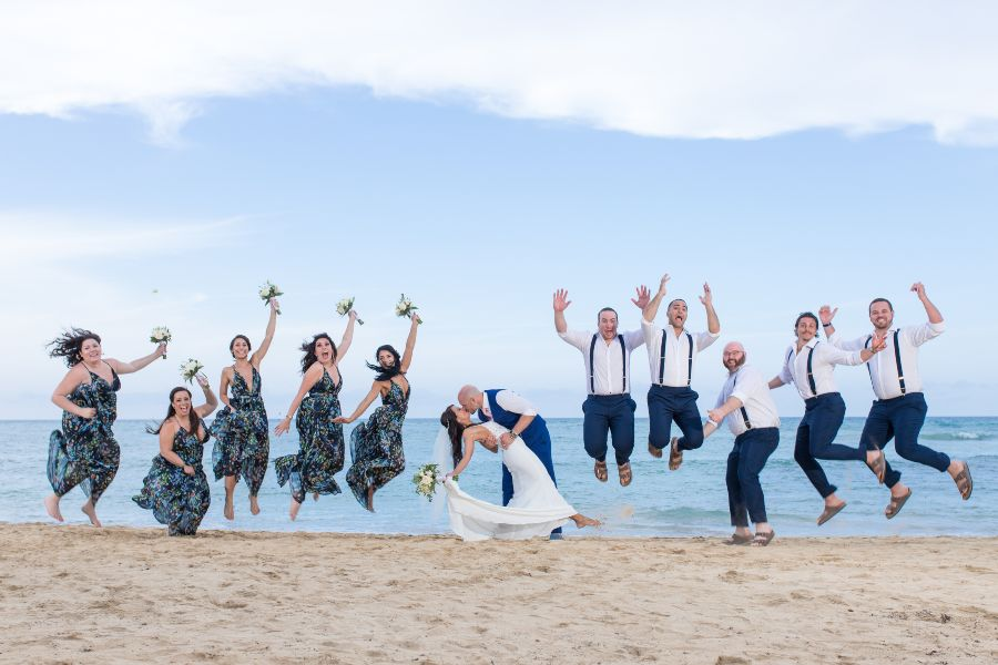 Fun Jumping Photo of Entire Bridal Party taken by Adventure Photos