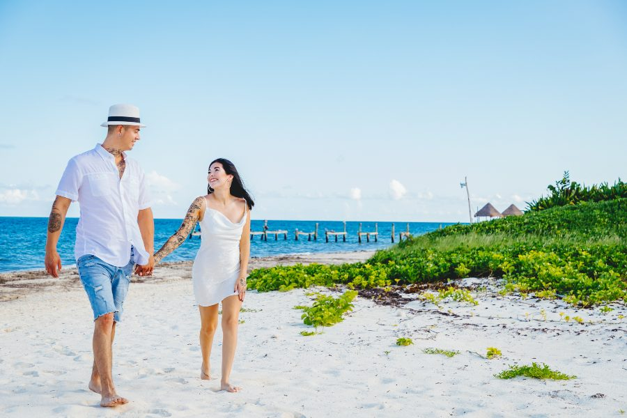 Couple on Beach During Photo Session with Adventure Photos at Now Resort & Spa