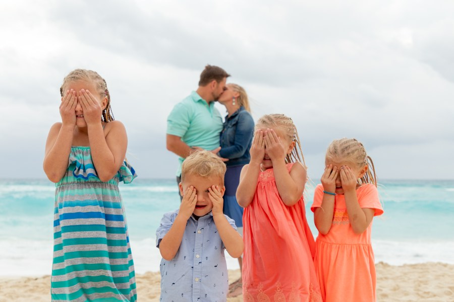 Fun Family Photo on Beach During Vacation by Adventure Photos