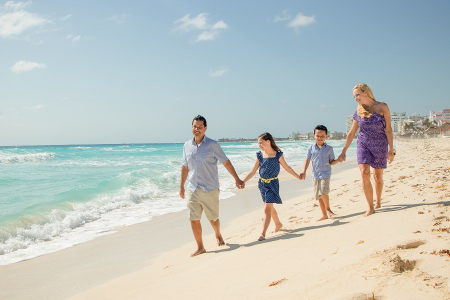 Family on the Beach at Now Resort during Lifestyle Photo Session by Adventure Photos