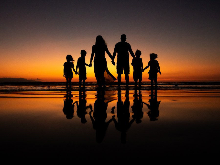 Family Photo at Sunset During Resort Vacation by Adventure Photos
