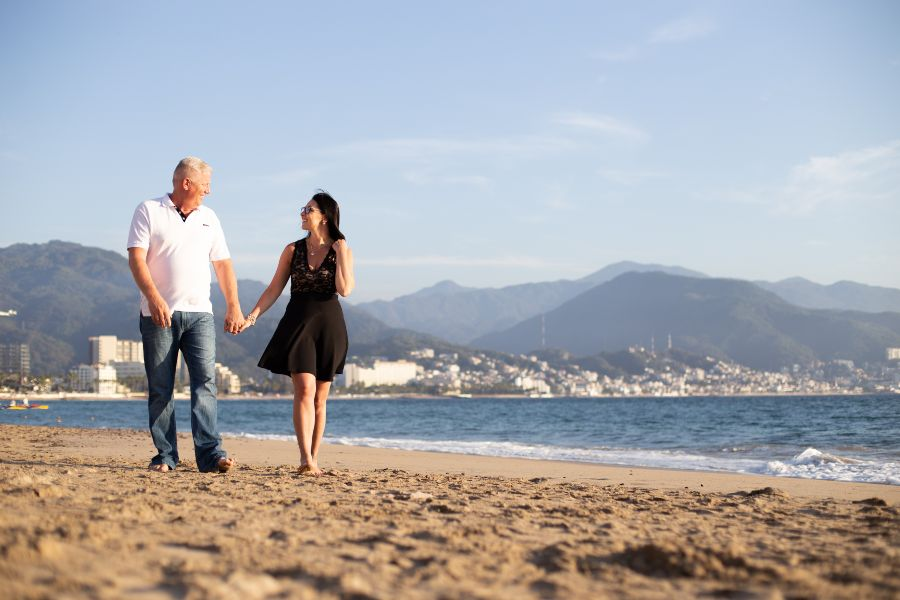 Couple Walking on Beach During Romantic Photo Shoot with Adventure Photos at Sunscape Resort & Spa