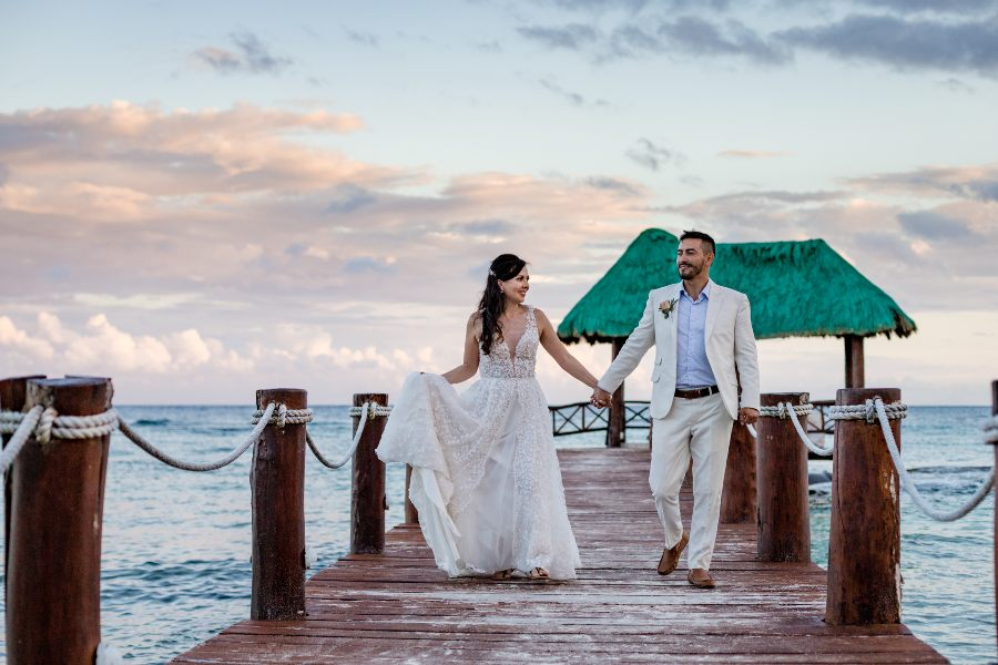 Destination Wedding Photo on Pier Captured by Adventure Photos at Sunscape Resort & Spa