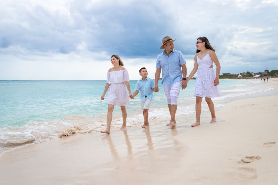 Family Walking on Beach for Lifestyle Photo Shoot at Sunscape Resort & Spa Photographed by Adventure Photos